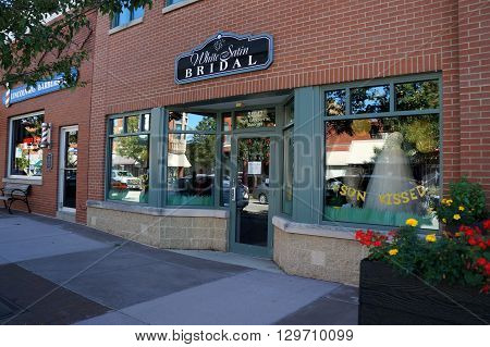 PLAINFIELD, ILLINOIS / UNITED STATES - SEPTEMBER 20, 2015: One may purchase a wedding gown at White Satin Bridal in downtown Plainfield.