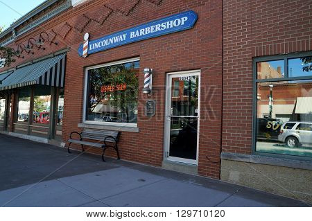PLAINFIELD, ILLINOIS / UNITED STATES - SEPTEMBER 20, 2015: One may have one's hair cut at the Lincolnway Barbershop in downtown Plainfield.