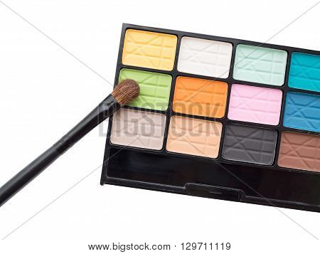 Colorful eyeshadow palette with eye makeup brush - beauty makeup cosmetics - isolated cosmetics on white background