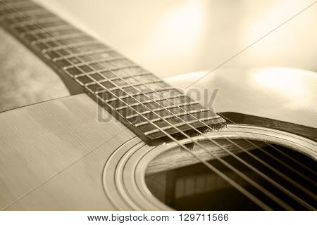 Close up acoustic guitar detail vintage filter, stock photo