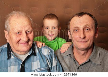 two elderly men with boy