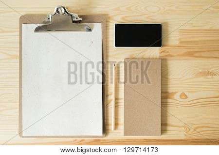 kraft on wooden eco business project concept