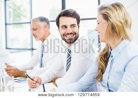 Business colleagues talking in a meeting at office