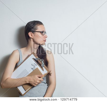 Young woman thinks about a business project