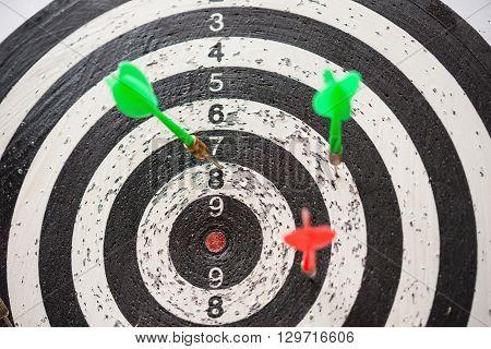 darts and dartboard close up horizontal composition