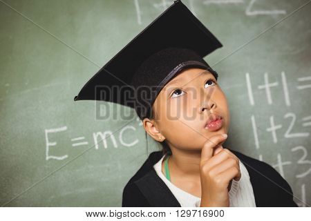 Schoolchild wearing a graduation outfit at school
