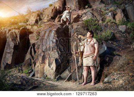 Caveman And Woman In Animal Skin