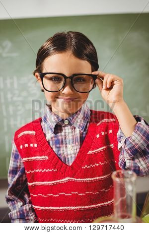 Boy touching his glasses at school