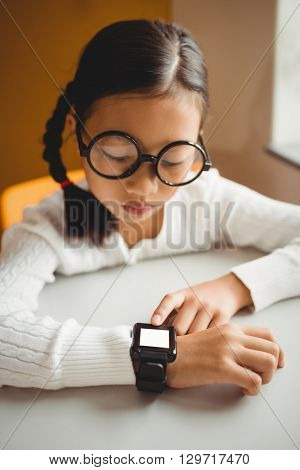 Schoolchild wearing a smart watch at school