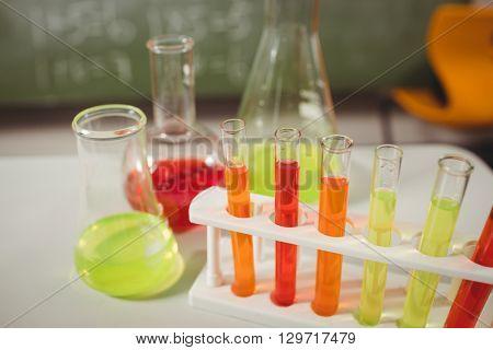 Test tube and beaker on desk at school