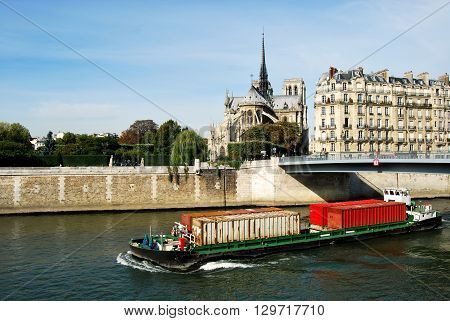 A barge for transporting containers through Paris on the Seine