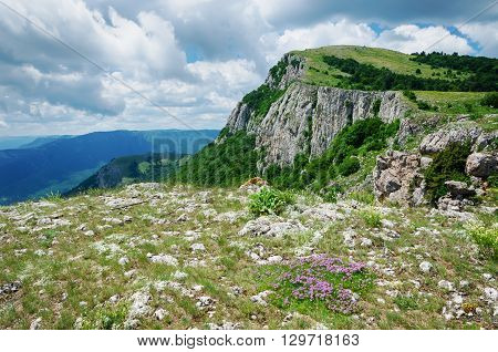 view from the cliff beautiful landscape Crimean mountains flowering alpine meadows Karabi- Yayla Crimea Russia