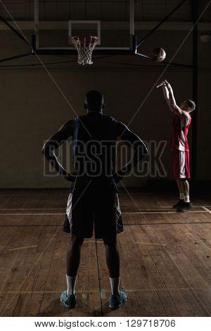 Basketball players training together on a gym
