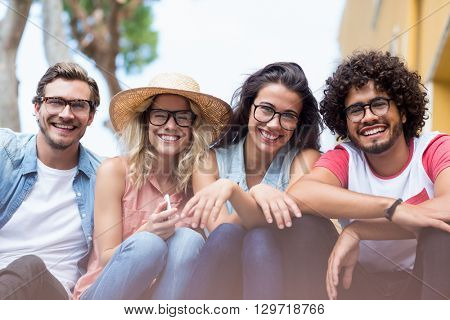 Portrait of friends in spectacles sitting side by side