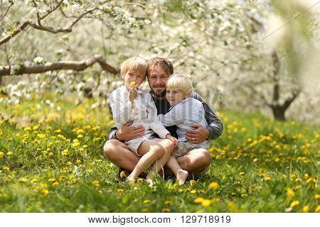 Portrait Of Happy Father And Two Young Children