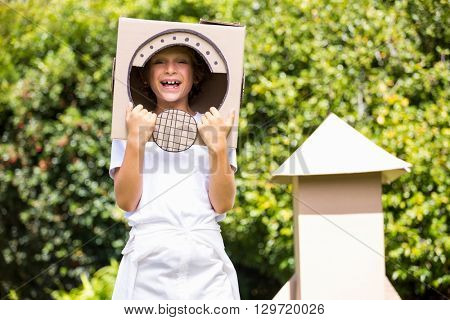 A little girl is smilling with her costume in a garden