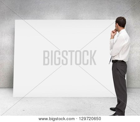 Thoughtful classy businessman looking away against composite image of white card