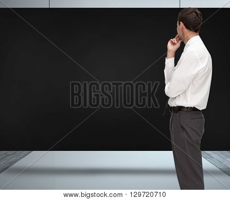 Thoughtful classy businessman looking away against composite image of black card