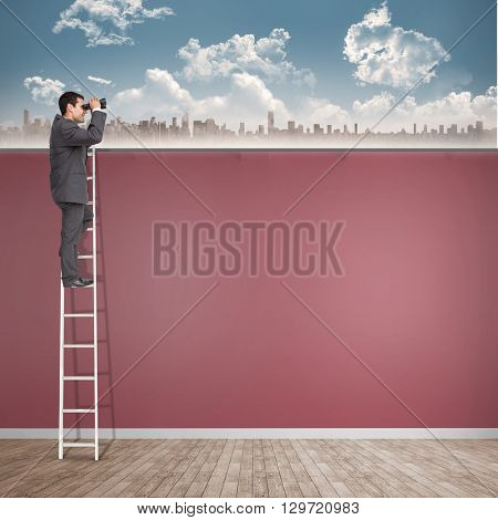 Businessman looking on a ladder against room with wooden floor