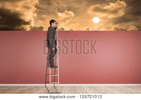 Happy businessman standing on ladder against room with wooden floor