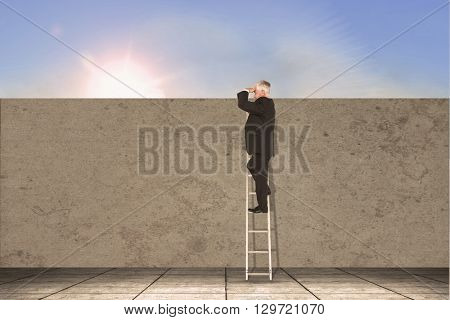 Mature businessman standing on ladder against blue sky with white clouds