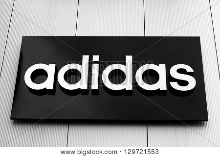 Bucharest, Romania, May 4, 2016: Adidas sign and logo. Adidas is a German multinational corporation that designs and manufactures sports shoes, clothing and accessories headquartered in Bavaria