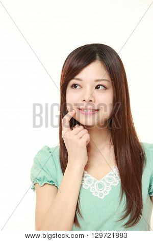 portrait of young Japanese woman thinks about something