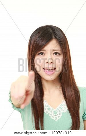 portrait of young Japanese woman shocked on white background