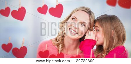 Mother listening to daughter against close up of swivel chair in an office