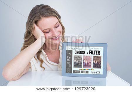 Woman showing tablet pc against smartphone app menu
