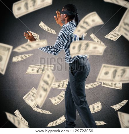 Blindfolded businessman with arms out against grey background