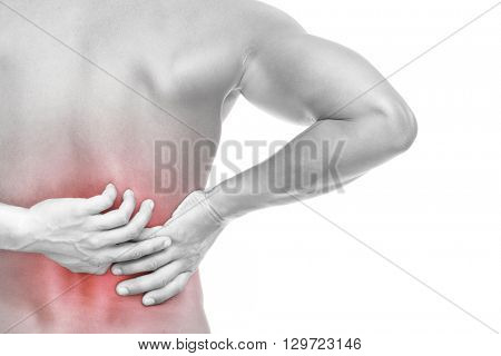 Back view of a young muscular man holding his back in pain, isolated on white background