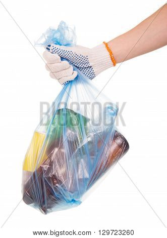 Scavenging, hand holds a full garbage bag with household waste isolated on white background
