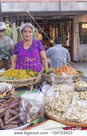 KRABI THAILAND - APRIL 9: Unidentified woman seller at Chawfa street market on April 9 2015 in Krabi Thailand.