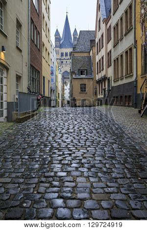 Cologne, Germany - May 16: This is one of the many small pedestrian streets in the center of the old town in the evening May 16, 2013 in Cologne, Germany.