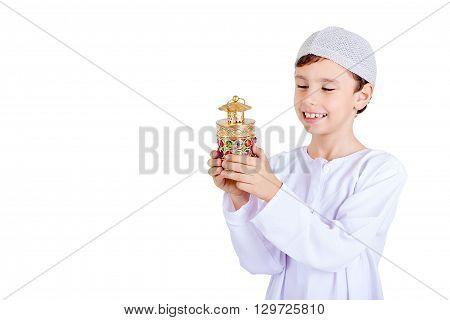 Ramadan Kareem - Happy young kid playing with Ramadan lantern - Isolated on white background