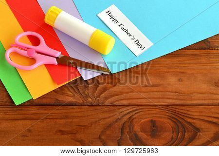 Set for greeting card father's day. Happy father's day. Kids crafts. Paper sheet, scissors, glue. How to make a greeting card father's day