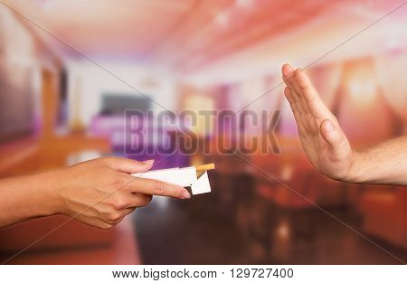 Rjection of the proposal to light a cigarette in a restaurant