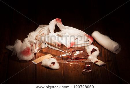 Broken glass in the blood, a means of dressing on a wooden table