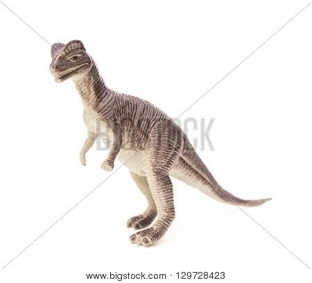 side view brown Dilophosaurus toy on a white background