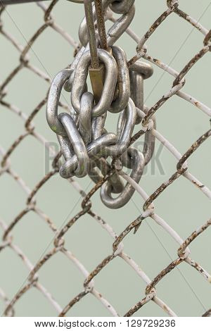 Lock on steel chain link security fence