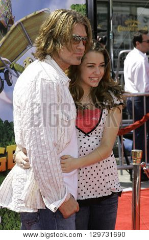 Miley Cyrus and Billy Ray Cyrus at the Los Angeles premiere of 'Over The Hedge' held at the Mann Village Theatre in Westwood, USA on April 30, 2006.