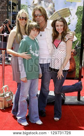 Billy Ray Cyrus and Miley Cyrus at the Los Angeles premiere of 'Over The Hedge' held at the Mann Village Theatre in Westwood, USA on April 30, 2006.