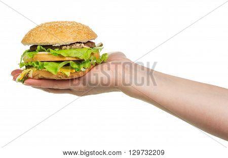 Female hand holding a hamburger isolated on white background