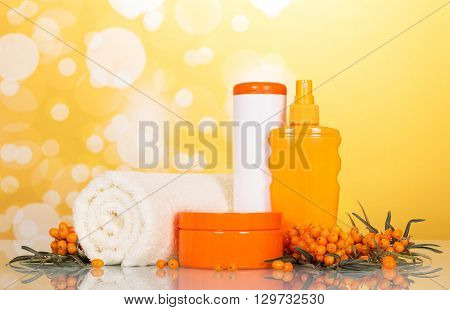Towels and toiletries in the bathroom on an abstract yellow background
