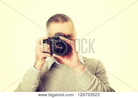 Mature man with photo camera
