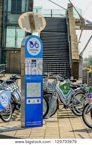 STIRLING SCOTLAND - MAY 8 2016: Nextbike bicycle rental station at Stirling train station in Scotland.