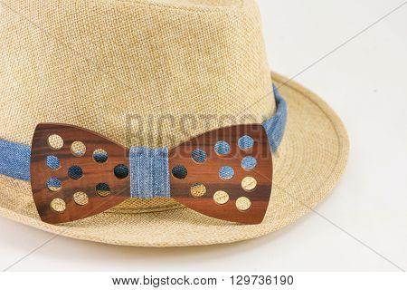 Wooden Bow Tie Around A Hat.