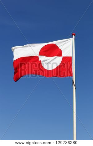 The flag of Greenland waving in the sky