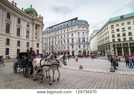VIENNA - APRIL,24: Tourists ride in a fiakre in old city centre on April 24, 2016 in Vienna